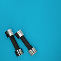 Metal small dumbbells on a blue background - PhotoDune Item for Sale