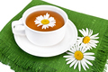 Herbal tea in a white cup with camomile - PhotoDune Item for Sale