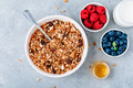 Granola cereals with fresh berries, almonds, milk and honey for breakfast. - PhotoDune Item for Sale