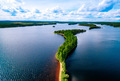 Aerial top view of blue lakes with islands and green forests in Finland. - PhotoDune Item for Sale
