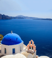 White church with blue dome against blue sea and sky background. Oia Santorini, Greece. - PhotoDune Item for Sale