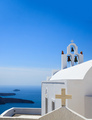 Santorini, Greece. White church and bells against blue sea and sky background. - PhotoDune Item for Sale