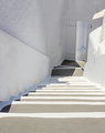 Santorini, Greece. White architecture, staircase going down to an open door. - PhotoDune Item for Sale
