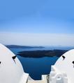 Santorini, Greece. White architecture detail against blue sea background. - PhotoDune Item for Sale