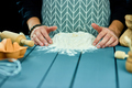 Man forming the dough on a floured surface and kneading it with his hands. - PhotoDune Item for Sale