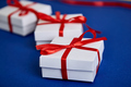 Luxury white gift boxes with red ribbon - PhotoDune Item for Sale