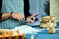 Man using electronic tablet pc in kitchen for baking. - PhotoDune Item for Sale