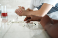 Happy Interracial Couple Playing Domino At Home - PhotoDune Item for Sale