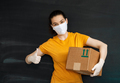 Delivery woman holding cardboard box - PhotoDune Item for Sale