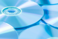 Stack of CD or DVD in blue tone as background. Soft focus. - PhotoDune Item for Sale