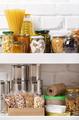 Set of non-perishable foods on pantry shelf on brick wall background - PhotoDune Item for Sale