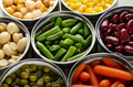 Canned vegetables in opened tin cans on kitchen table - PhotoDune Item for Sale