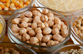 Chickpeas closeup in glass bowl on wooden kitchen table - PhotoDune Item for Sale