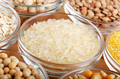 Rice closeup in glass bowl on wooden kitchen table, non-perishable, long shelf life food concept - PhotoDune Item for Sale