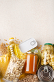 Flat lay view at kitchen table full with non-perishable foods. Spase for text - PhotoDune Item for Sale