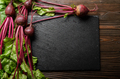 Top view at fresh organic beets with leaves on wooden rustic table close up view - PhotoDune Item for Sale