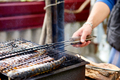 Men grilling fish mackerel on barbecue cooked on the grill in the open air flow - PhotoDune Item for Sale