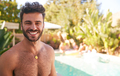 Portrait Of Bare Chested Hispanic Man Outdoors With Friends Enjoying Summer Pool Party - PhotoDune Item for Sale