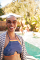 Portrait Of African American Woman With Shaved Head Outdoors With Friends Enjoying Summer Pool Party - PhotoDune Item for Sale