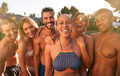 Portrait Of Group Of Friends Outdoors Relaxing By Swimming Pool And Enjoying Summer Party - PhotoDune Item for Sale