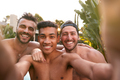 Three Male Friends At Summer Pool Party Taking Selfie On Mobile Phone - PhotoDune Item for Sale