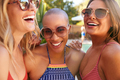 Group Of Smiling Female Friends Wearing Sunglasses Outdoors Relaxing And Enjoying Summer Pool Party - PhotoDune Item for Sale