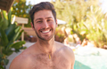 Portrait Of Smiling Bare Chested Man Outdoors With Friends At Summer Pool Party - PhotoDune Item for Sale