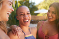 Group Of Smiling Female Friends Outdoors Relaxing And Enjoying Summer Pool Party - PhotoDune Item for Sale