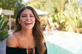 Portrait Of Smiling Hispanic Woman Outdoors With Friends Enjoying Summer Pool Party - PhotoDune Item for Sale
