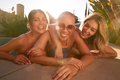 Portrait Of Three Female Friends Outdoors Relaxing In Swimming Pool And Enjoying Summer Pool Party - PhotoDune Item for Sale