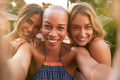 Three Female Friends At Summer Pool Party Taking Selfie On Mobile Phone - PhotoDune Item for Sale