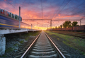 Railway station with freight trains at colorful sunset - PhotoDune Item for Sale