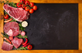 Raw meat steaks on a dark background ready to roasting - PhotoDune Item for Sale