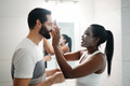 Woman Applying Beauty Mask And Skin Cleanser To Man - PhotoDune Item for Sale