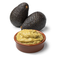 Bowl guacamole with avocado in the background - PhotoDune Item for Sale