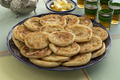 Fresh baked meloui, Moroccan pancakes, butter and tea - PhotoDune Item for Sale