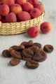 Dried apricots with a basket fresh ones in the background - PhotoDune Item for Sale