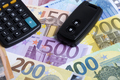 Car key on a European money background - PhotoDune Item for Sale