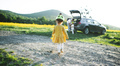 Rear view os small girl with family going on cycling trip in countryside - PhotoDune Item for Sale