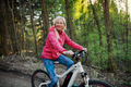 Active senior woman with e-bike cycling outdoors in nature - PhotoDune Item for Sale