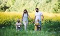 Family with two small children and face masks on cycling trip in countryside - PhotoDune Item for Sale