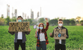Group of young activists with placards standing outdoors by oil refinery, protesting - PhotoDune Item for Sale