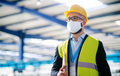 Technician or engineer with protective mask and helmet standing in industrial factory - PhotoDune Item for Sale