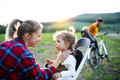 Family with two small children on cycling trip, having fun - PhotoDune Item for Sale
