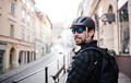 Delivery man courier with bicycle helmet and sunglasses in town - PhotoDune Item for Sale