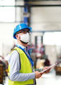 Technician or engineer with protective mask and helmet working in industrial factory - PhotoDune Item for Sale