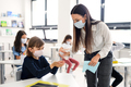 Teacher, children with face mask at school after covid-19 quarantine and lockdown - PhotoDune Item for Sale