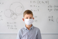Boy with face mask back at school after covid-19 quarantine and lockdown - PhotoDune Item for Sale