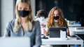 Young people with face masks back at work or school in office after lockdown - PhotoDune Item for Sale