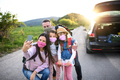 Family with two small daughters on trip outdoors in nature, wearing face masks - PhotoDune Item for Sale